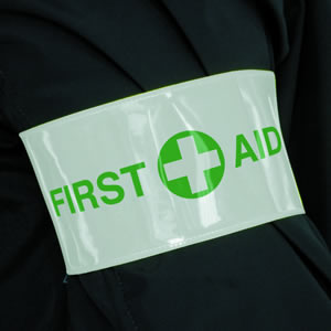 First aid armband sign.