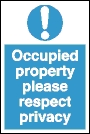 Occupied property please respect privacy ! sign.