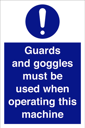 Guards and goggles must be used when operating this machine sign.