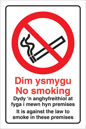 Dim ysmygu no smoking didy n anghyfreithiol at i mewn hon yn adeilad. it is illegal to smoke on these premises. sign.