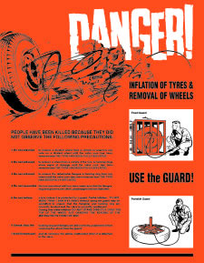 Danger! inflation of tyres & removal of wheels sign.