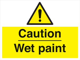 Caution wet paint sign.