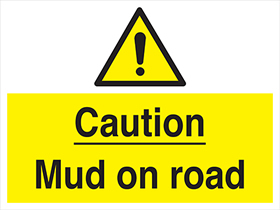 Caution mud on road sign.