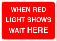 When red light shows wait here sign.