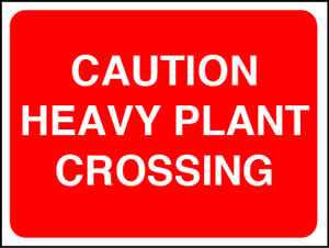 Caution heavy plant crossing sign.