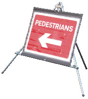 Pedestrians white arrow on red sign.
